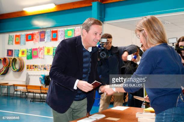 Former French presidential election candidate for the rightwing Debout la France party Nicolas DupontAignan prepares to vote at a polling station...