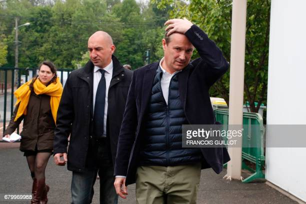 Former French presidential election candidate for the rightwing Debout la France party Nicolas DupontAignan arrives at a polling station after...