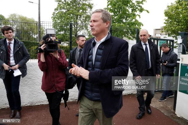 Former French presidential election candidate for the rightwing Debout la France party Nicolas DupontAignan leaves after voting at a polling station...