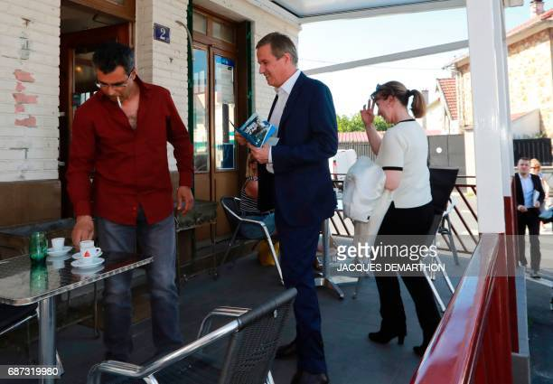 Former French presidential election candidate for the rightwing Debout la France party Nicolas DupontAignan and deputy Ouiza Haddad meet with members...