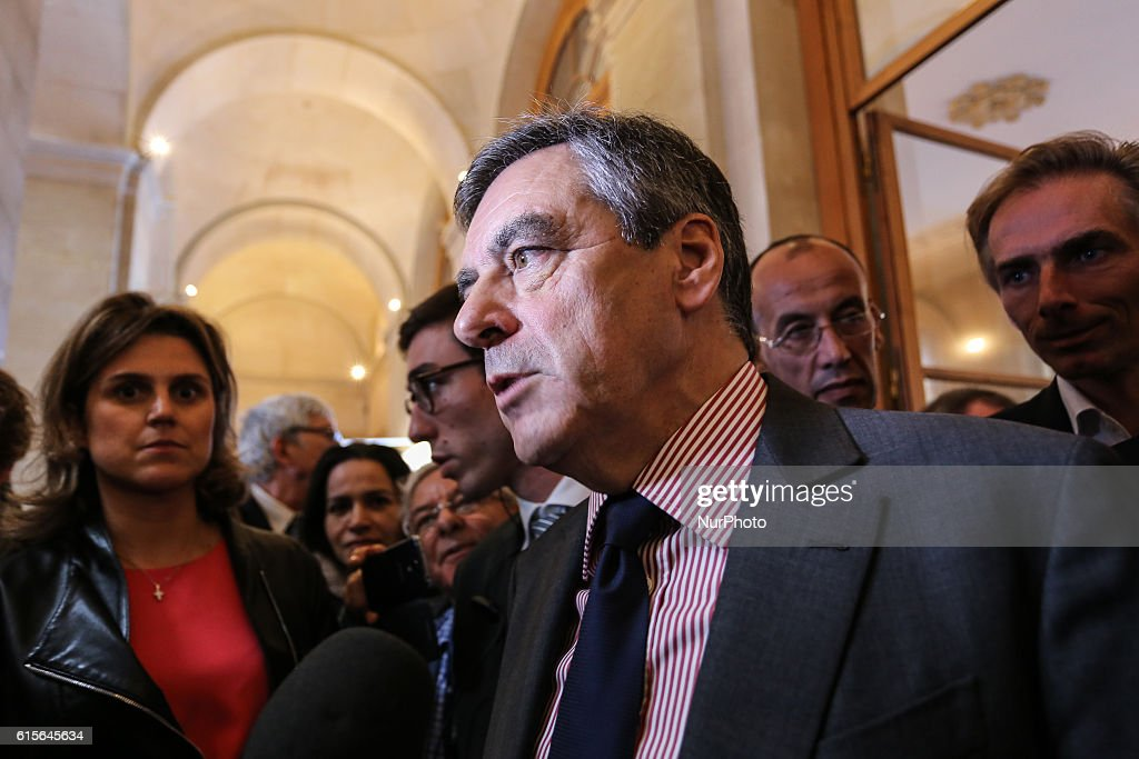 Former French Prime Minister and Candidate for the right-wing Les Republicains (LR) party primaries ahead of the 2017 presidential Francois Fillon talks to the press on October 18, 2016 at the salon 'Planete PME' (SME planet) in Paris.