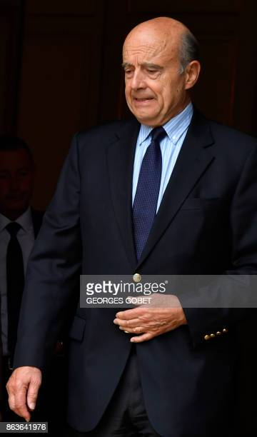 Former French Prime Minister and current Mayor of Bordeaux Alain Juppe prepares to welcome current French Prime Minister Edouard Philippe as he...