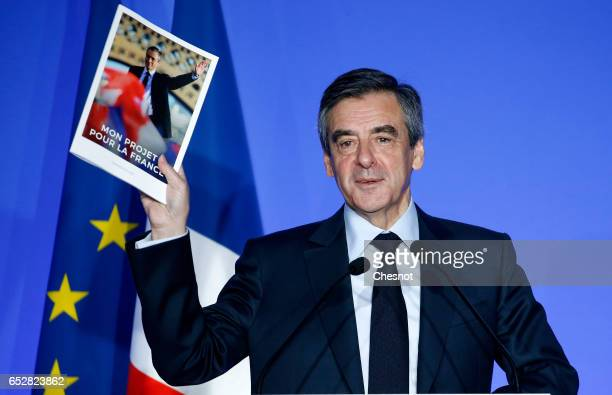 Former French prime minister and French presidential election candidate for the rightwing 'Les Republicains' political party Francois Fillon shows...