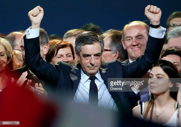 Former French Prime Minister and French presidential elections candidate for the rightwing 'Les Republicains' political party Francois Fillon waves...