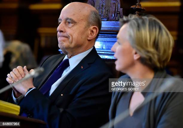 Former French prime minister and Mayor of Bordeaux Alain Juppe and first deputy mayor Virginie Calmels preside over an extraordinary session of the...