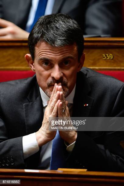 Former French prime minister and MP of La Republique en Marche Manuel Valls looks on as he attends a session of questions to the government at the...