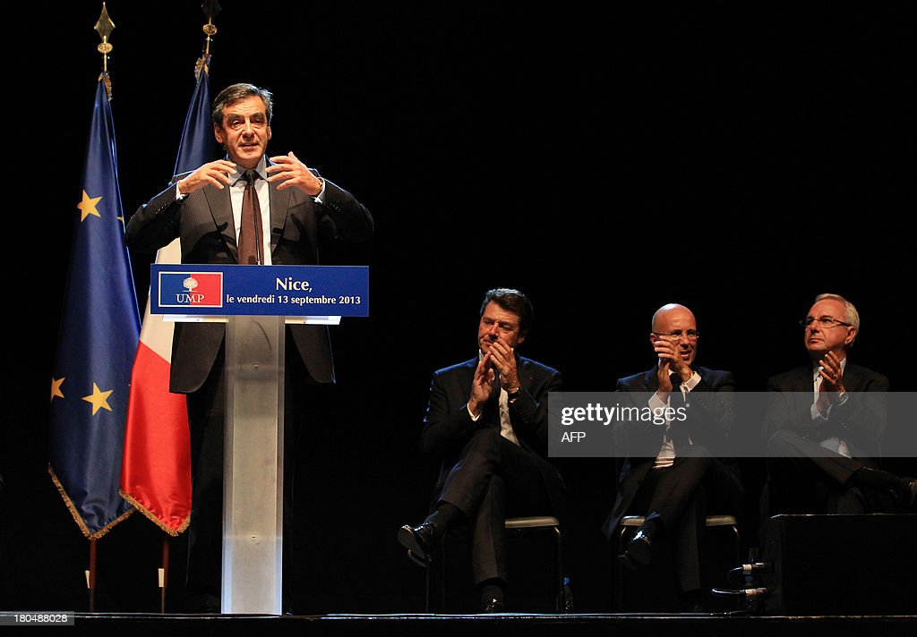 Former French prime minister and right-wing UMP party member Francois Fillon (L) delivers a speech as (2ndL-R) Nice's mayor Christian Estrosi, Fillon's former campaign director Eric Ciotti and Antibes' mayor Jean Leonetti applaud during a meeting in Nice, southeastern France, on September 13, 2013.