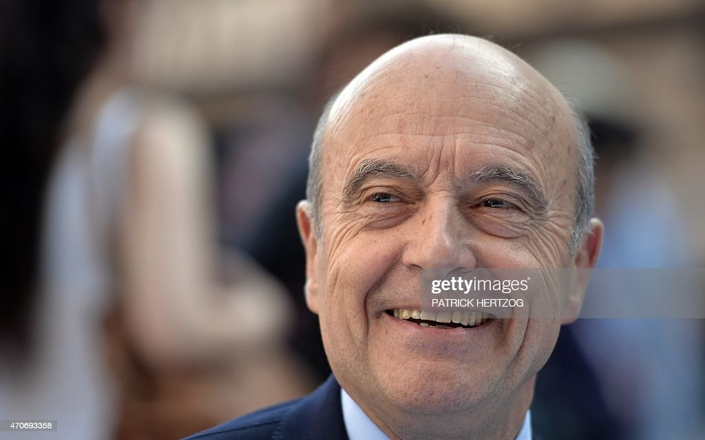 Former French Prime Minister and UMP right-wing opposition party member, politician <a gi-track='captionPersonalityLinkClicked' href=/galleries/search?phrase=Alain+Juppe&family=editorial&specificpeople=235359 ng-click='$event.stopPropagation()'>Alain Juppe</a>, seated in a terrace at Cathedral square, smiles as he talks with journalists in Strasbourg, eastern France, on April 22, 2015, during a visit as part of UMP's internal election campaign. The vote to choose the UMP candidate for 2017 French presidential election is scheduled in November 2016.