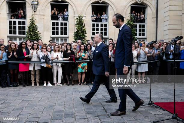 Former French Prime Minister Bernard Cazeneuve and the new Prime Minister the right wing Mayor of Le Havre Edouard Philippe attend a power handover...