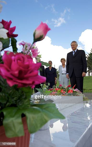 Former French Prime minister Dominique de Villepin spends some moment in silence in front of the grave of French poet Aime Cesaire eyed by Former...