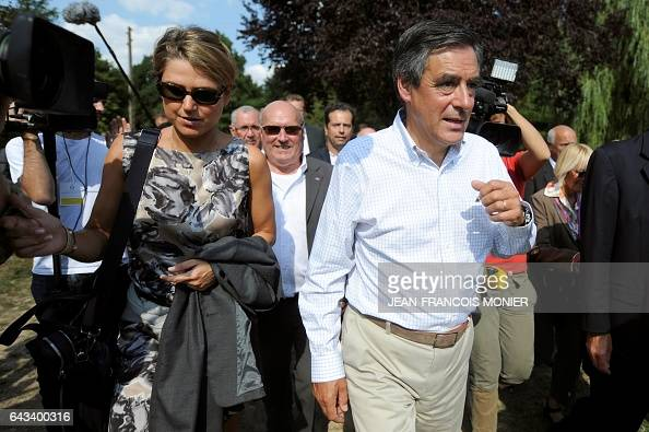 Former French Prime Minister Francois Fillon and his press agent French Press attache Caroline Morard leave after a meeting in DomfrontenChampagne...