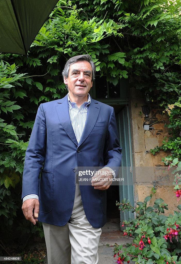 Former French Prime Minister Francois Fillon, member of a triumvirate leading the French right-wing UMP party leaves after delivering a speech during a meeting with militants on August 27, 2014 in Rouez-en-Champagne, western France.