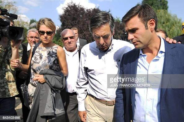 Former French Prime Minister Francois Fillon speaks with his advisor Eric Chomaudon next to his press agent Caroline Morard after a meeting in...