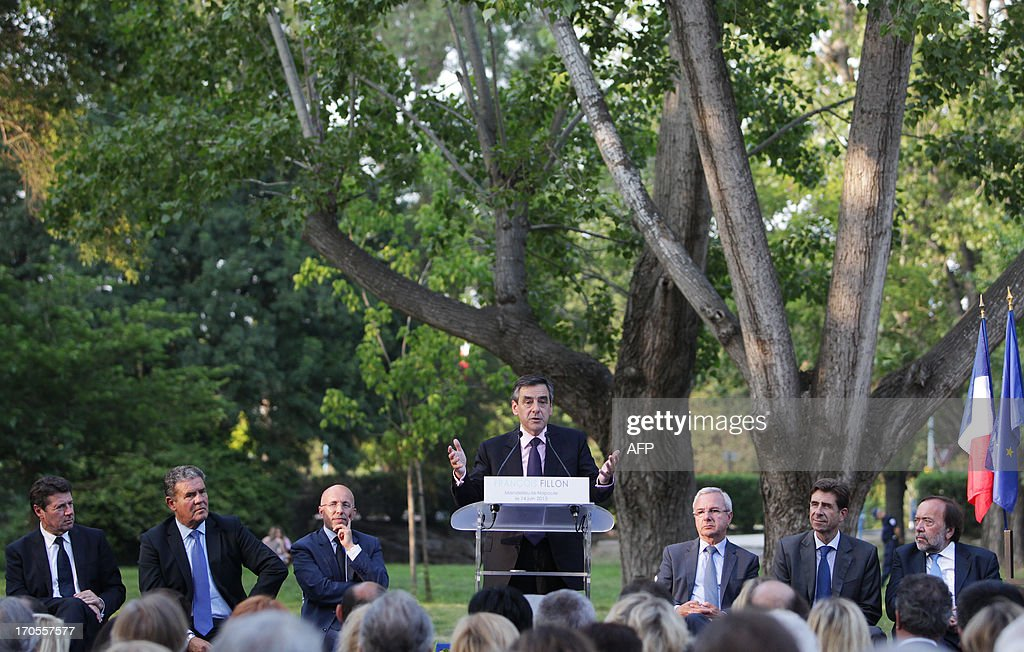 Former French prime minister François Fillon (C) delivers a speech during a meeting, on June, 14, 2013, in Mandelieu-la-Napoule, southeastern France, surrounded by (L-R) Nice's mayor Christian Estrosi, Mandelieu-la-Napoule's mayor Henri Leroy, Fillon's former campaign director, Eric Ciotti, Antibes' mayor Jean Leonetti, Peone's mayor Charles-Ange Ginesy, and European deputy Gaston Franco. Fillon told his supporters he will propose a 'serious and realistic alternative programme' to win the 2017 presidential elections.