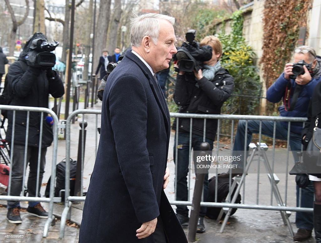 Former French prime minister <a gi-track='captionPersonalityLinkClicked' href=/galleries/search?phrase=Jean-Marc+Ayrault&family=editorial&specificpeople=551961 ng-click='$event.stopPropagation()'>Jean-Marc Ayrault</a> arrives to attend the funeral of Elsa Cayat, a psychoanalyst and contributor at the French satirical weekly Charlie Hebdo, on January 15, 2015 at the Montparnasse cemetery in Paris. Twelve people were killed, including Cayat and cartoonists Charb, WolinsKi, Cabu and Tignous and deputy chief editor Bernard Maris, when gunmen armed with Kalashnikovs and a rocket-launcher opened fire in the Paris offices of Charlie Hebdo on January 7. AFP PHOTO / DOMINIQUE FAGET