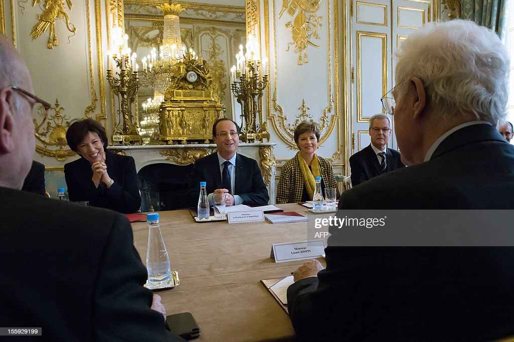 Former French Prime Minister Lionel Jospin (R) and the members of the committee on France's Renovation and Moralization of the political scene, including former Health minister Roselyne Bachelot (L) sit prior to give their report to France's President Francois Hollande (C) on November 9, 2012 at the Elysee Palace in Paris.