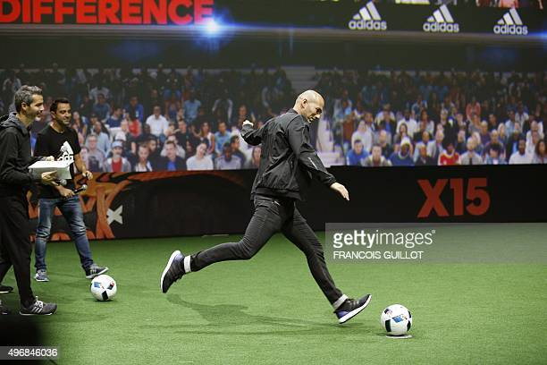 Former French soccer player Zinedine Zidane kicks the official football of the upcoming Euro 2016 football championships during its presentation on...