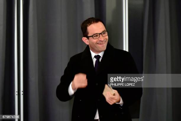 Former French Socialist party candidate Benoit Hamon exits a polling booth before casting his ballot at a polling station in Trappes Paris' suburb on...