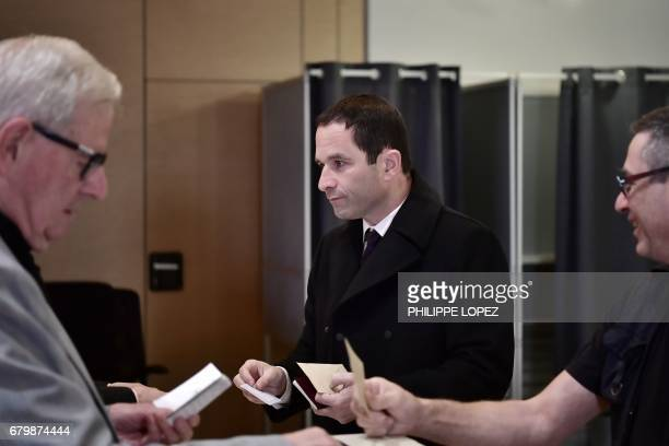 Former French Socialist party candidate Benoit Hamon prepares to vote at a polling station in Trappes Paris' suburb on May 7 during the second round...
