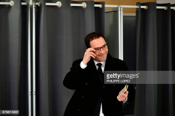 Former French Socialist party candidate Benoit Hamon smiles as he exits a polling booth before casting his ballot at a polling station in Trappes...