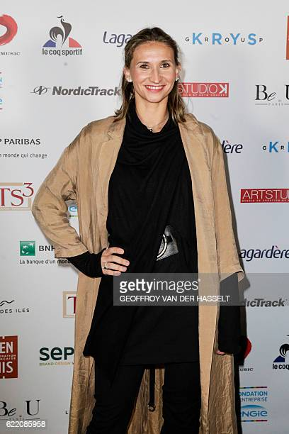 Former French Tennis player Tatiana Golovin poses during a photocall for a gala evening of the association 'Fete le Mur' created by French former...