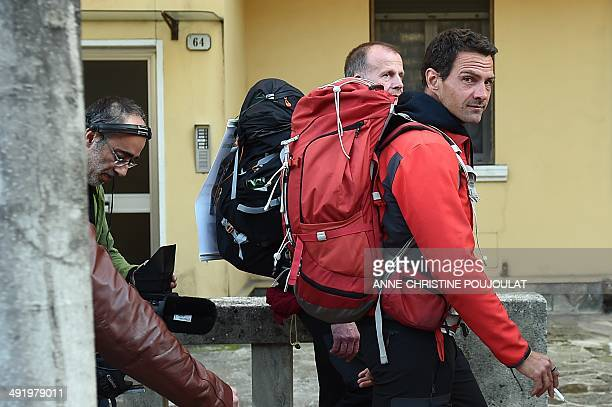 Former French trader Jerome Kerviel walks with French priest Patrice Gourrier in Vintimille near the French border on his way to enter France from...