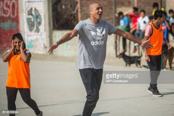 Former French world football champion David Trezeguet celebrates a goal during a match with children at San Pablo Mirador community Chancay district...