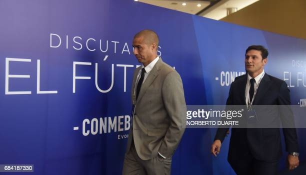 Former FrenchArgentine player David Trezeguet and Argentine Javier Zanetti arrive at the Conmebol headquarters in Luque Paraguay on May 17 2017 to...