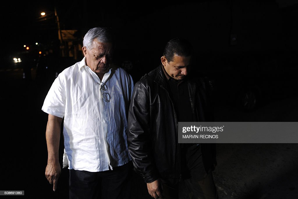 Former general and congressman Mauricio Ernesto Vargas (L) and attorney Lisandro Quintanilla, legal representative of former military officer Carlos Mauricio Guzmán Aguilar, are seen outside the headquarters of the Central Division of police investigations in San Salvador, El Salvador on February 6, 2016. Salvadoran police launched a raid to arrest 17 former military personnel one of whom is Aguilar, accused of killing six Jesuit priests in 1989, one of the most notorious atrocities of the country's bloody civil war. AFP PHOTO / Marvin RECINOS / AFP / Marvin RECINOS