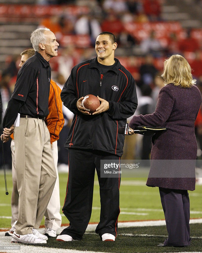 Former Georgia DE and current Cincinnati Bengal David Pollack comes back to campus and talks with his old coach before the game against Auburn at...