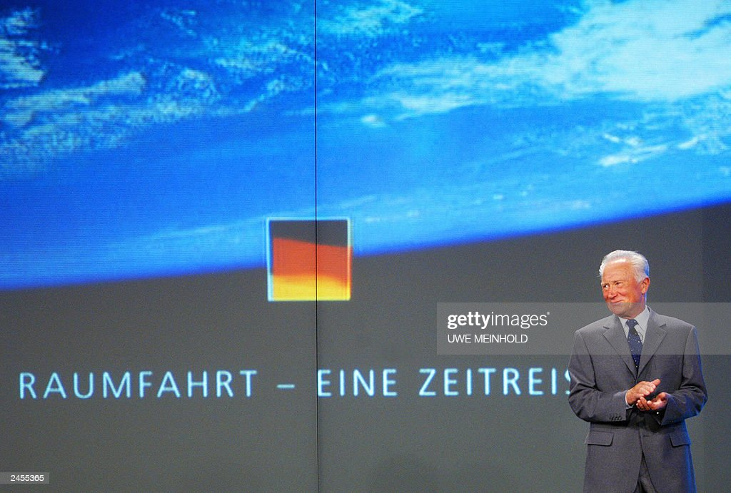 Former German astronaut Sigmund Jaehn stands on a podium, 30 August 2003 in the eastern town of Markneukirchen, during the celebrations of the 25th anniversary of the German crewed spaceflights. Sigmund Jaehn, of former GDR, was together with Russian astronaut Valerij Bykowski on 26 August 1978 the first German to start on spacecraft Sojus 31 a eight-day-long space-flight.