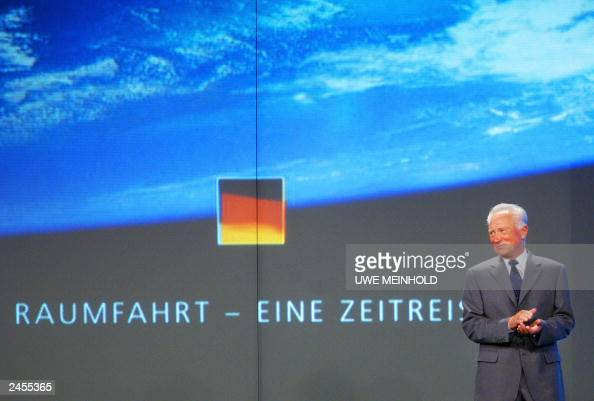 Former German astronaut Sigmund Jaehn stands on a podium 30 August 2003 in the eastern town of Markneukirchen during the celebrations of the 25th...