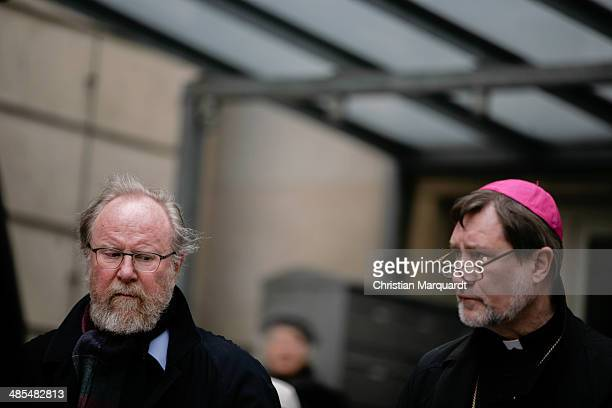 Former German Bundestag President Wolfgang Thierse and auxiliary Bishop Matthias Heinrich stand together during the ecumenical Good Friday procession...