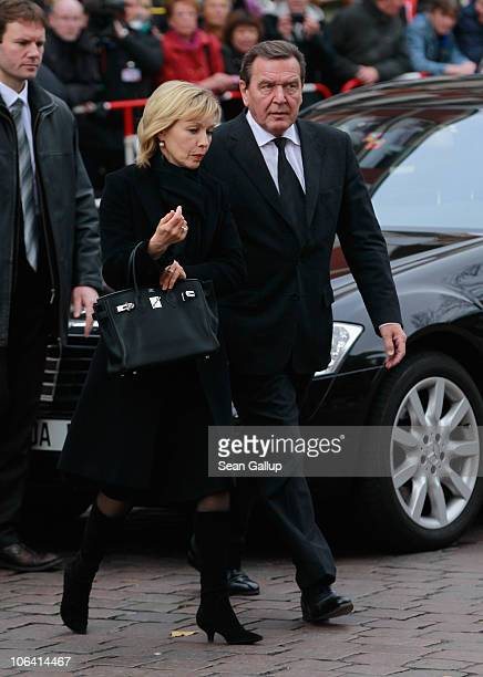 Former German Chancellor Gerhard Schroeder and his wife Doris SchroederKoepf arrive for the memorial service for Loki Schmidt wife of former German...