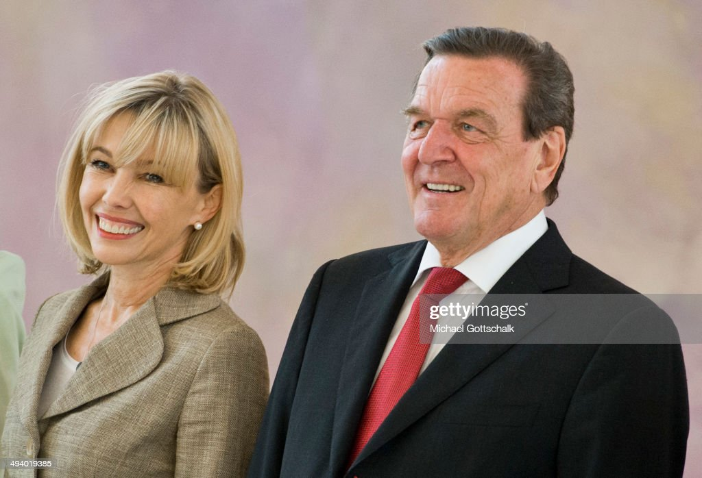 Former German chancellor Gerhard Schroeder and his wife <a gi-track='captionPersonalityLinkClicked' href=/galleries/search?phrase=Doris+Schroeder-Koepf&family=editorial&specificpeople=224024 ng-click='$event.stopPropagation()'>Doris Schroeder-Koepf</a> arrive for a reception in Bellevue Castle (Schloss Bellevue) on the occasion of Schroeders 70th birthday on May 27, 2014 in Berlin, Germany.
