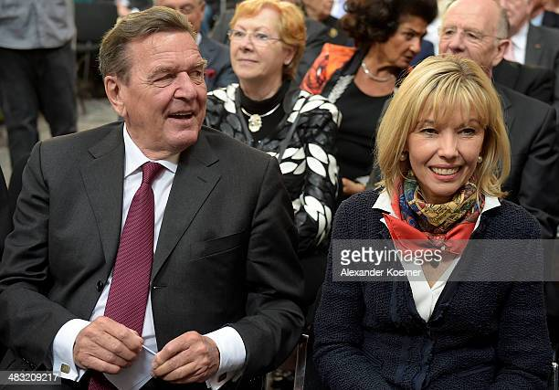 Former German Chancellor Gerhard Schroeder and his wife Doris SchroederKoepf attend a reception to celebrate his 70th birthday at City Hall on April...