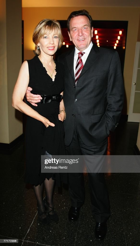 Former German Chancellor Gerhard Schroeder and his wife <a gi-track='captionPersonalityLinkClicked' href=/galleries/search?phrase=Doris+Schroeder-Koepf&family=editorial&specificpeople=224024 ng-click='$event.stopPropagation()'>Doris Schroeder-Koepf</a> attend the Quadriga Awards for outstanding contributions to society and world politics on October 3, 2007 in Berlin, Germany.