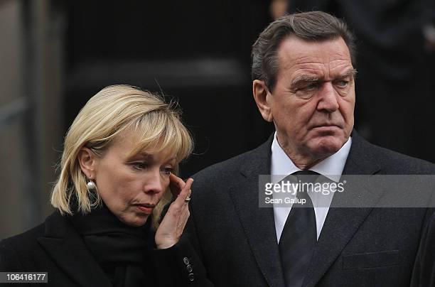 Former German Chancellor Gerhard Schroeder and his wife Doris SchroederKoepf depart following the memorial service for Loki Schmidt wife of former...