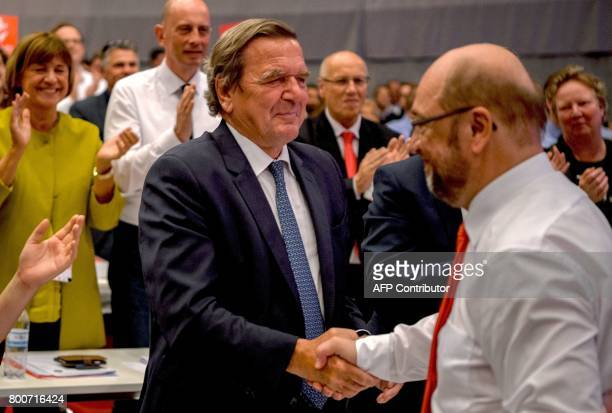 Former German Chancellor Gerhard Schroeder shakes hands with Martin Schulz chairman of Germany's social democraic SPD party and candidate for...