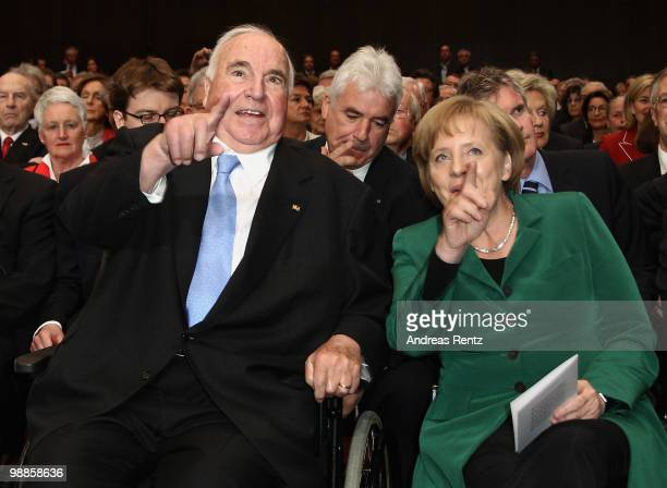 Former German Chancellor Helmut Kohl and German Chancellor Angela Merkel gesture during an official birthday reception to former German Chancellor...