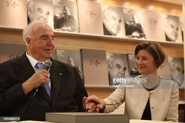 Former German Chancellor Helmut Kohl and his wife Maike KohlRichter attend the presentation of a photobook of Kohl at the booth of Collection Rolf...