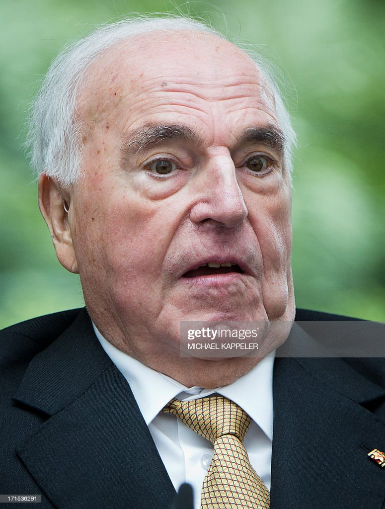 Former German Chancellor Helmut Kohl attends the unveiling of a memorial to German painter Kaethe Kollwitz in Berlin on June 26, 2103.