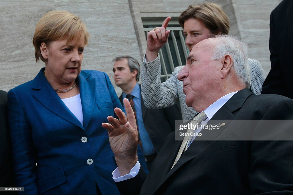 Former German Chancellor <a gi-track='captionPersonalityLinkClicked' href=/galleries/search?phrase=Helmut+Kohl&family=editorial&specificpeople=202518 ng-click='$event.stopPropagation()'>Helmut Kohl</a> (R)chats with current German Chancellor <a gi-track='captionPersonalityLinkClicked' href=/galleries/search?phrase=Angela+Merkel&family=editorial&specificpeople=202161 ng-click='$event.stopPropagation()'>Angela Merkel</a> from his wheelchair upon his arrival at a celebration of the German Christian Democrats (CDU) on October 1, 2010 in Berlin, Germany. The CDU is celebrating the 20th anniversary of the fusion of the West German and East German Christian Democrats in 1990. Germany will mark 20 years since the reunification of East and West Germany on October 3 following the collapse of the East German communist government one year before.