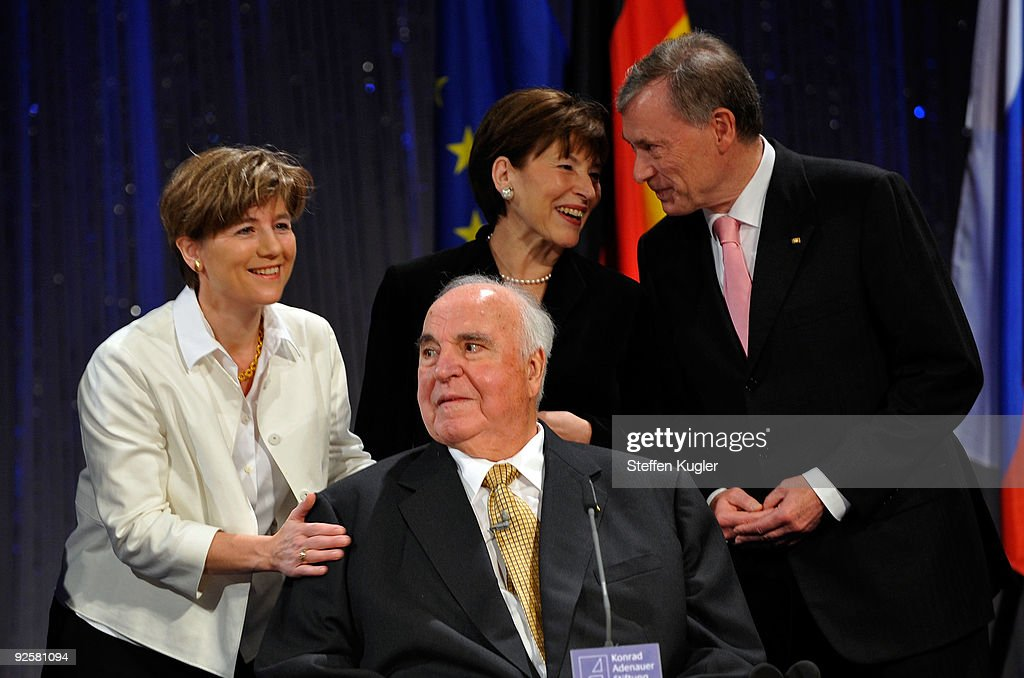 Former German Chancellor <a gi-track='captionPersonalityLinkClicked' href=/galleries/search?phrase=Helmut+Kohl&family=editorial&specificpeople=202518 ng-click='$event.stopPropagation()'>Helmut Kohl</a> is surrounded by his wife Maike Richter-Kohl and German presidential couple Horst and Eva Luise Koehler as he attends a ceremony at Friedrichstadtpalast on October 31, 2009 in Berlin, Germany. The event organized by The Konrad Adenauer Foundation takes place under the motto: 'The Fall of the Wall and Reunification - the Victory of Freedom.' Bush, Gorbachev and Kohl played key roles as the peaceful revolution unfolded in East Germany in the autumn of 1989. Their cooperation would pave the way for German reunification in 1990.