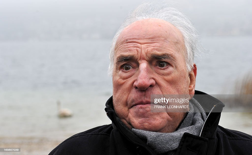 Former German Chancellor Helmut Kohl poses at lake Tegernsee in Bad Wiessee, southern Germany on April 5, 2013 while being on a vacation at the Medical Park Clinic.