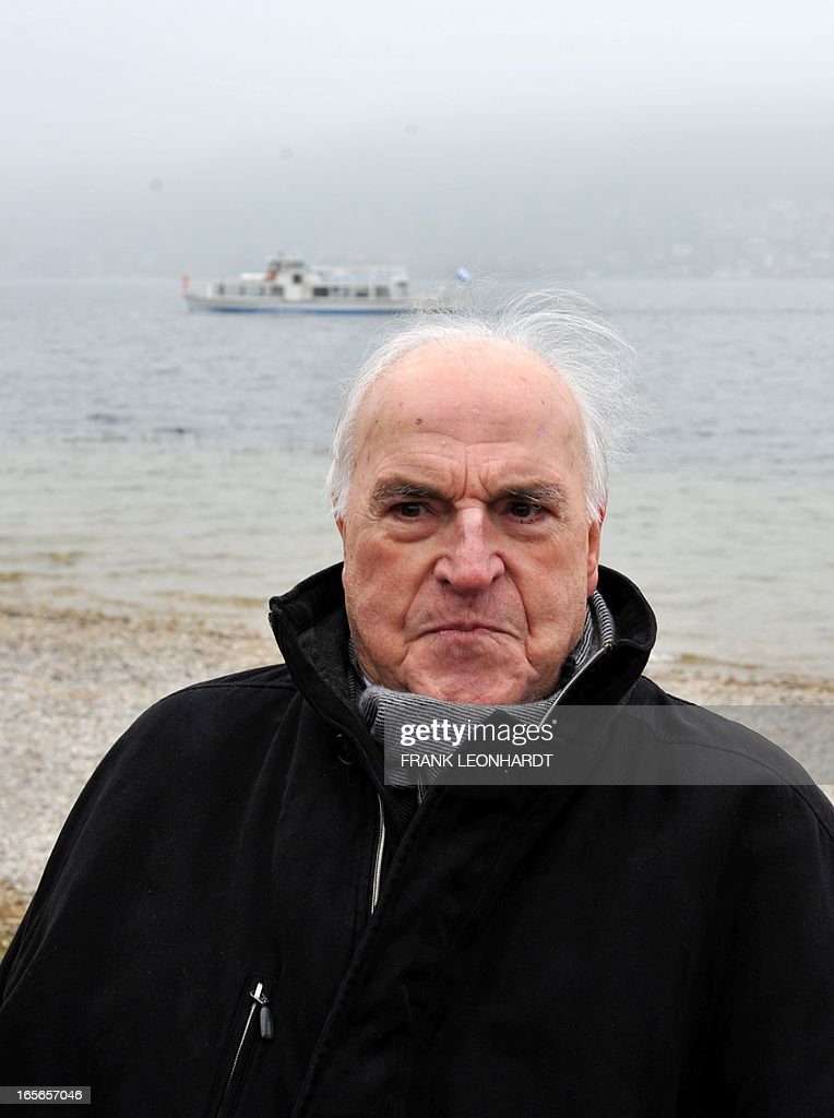 Former German Chancellor Helmut Kohl poses at lake Tegernsee in Bad Wiessee, southern Germany on April 5, 2013 while being on a vacation at the Medical Park Clinic. AFP PHOTO / FRANK LEONHARDT GERMANY OUT