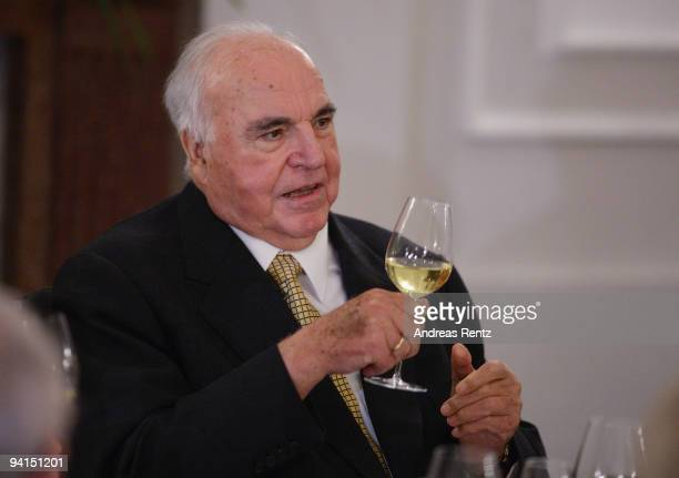 Former German Chancellor Helmut Kohl raise a glass of sparkling wine during a private dinner at Bellevue Pallace on December 8 2009 in Berlin Germany...