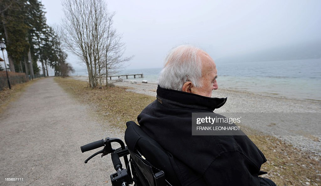 Former German Chancellor Helmut Kohl sits in his wheelchair at the esplanade of lake Tegernsee in Bad Wiessee, southern Germany on April 5, 2013 while being on a vacation at the Medical Park Clinic.