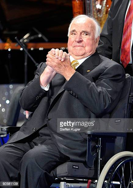 Former German Chancellor Helmut Kohl welcomes his guests during an event at Friedrichstadtpalast on October 31 2009 in Berlin Germany The event...