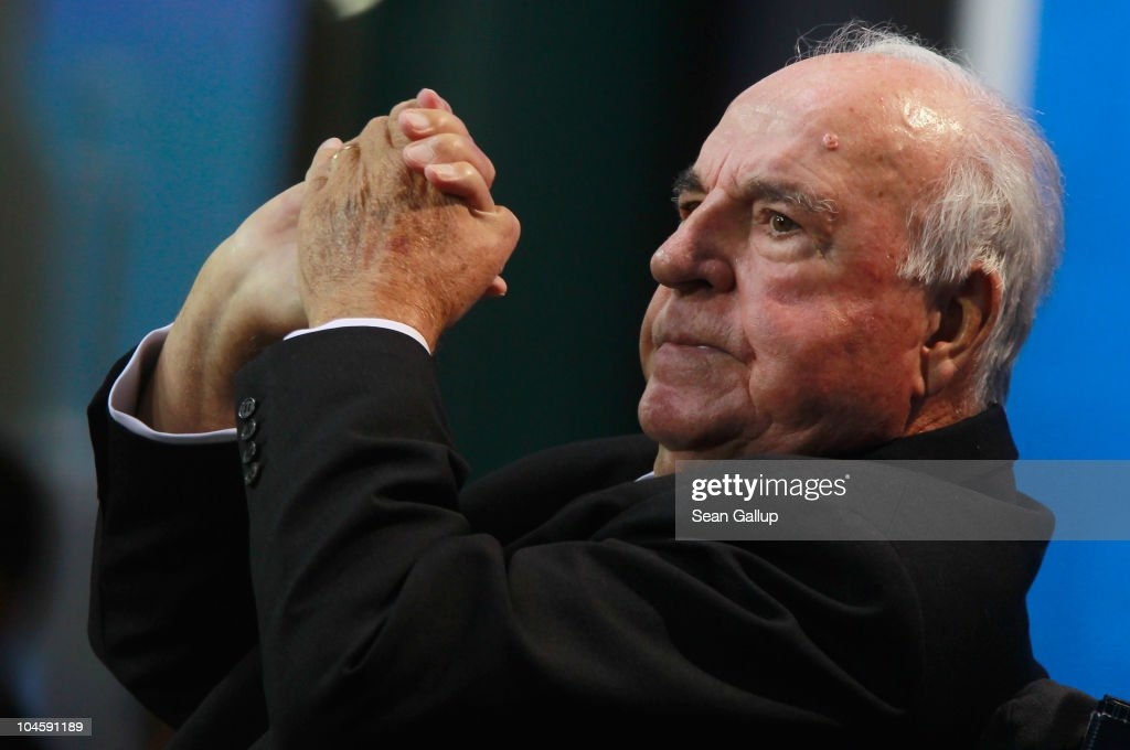 Former German Chancellor Helmut Kohl whose initiatives made German reunification in 1990 possible gestures after speaking at a celebration of the...